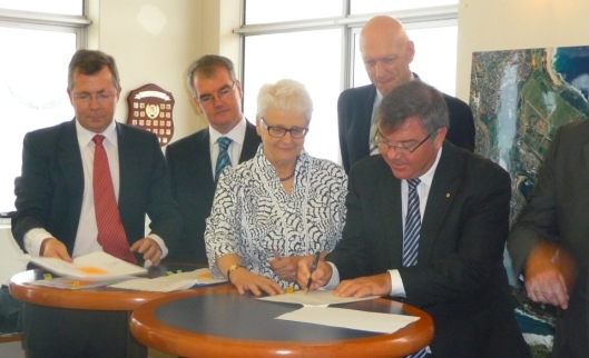 Special Minster of State Gary Gray signing Western Bushland transfer 2 March 2012